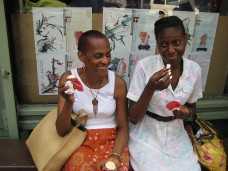 Two Black Women Eating Red Velvet CAke
