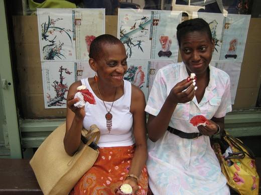 Two Black Women Eating Red Velvet CAke